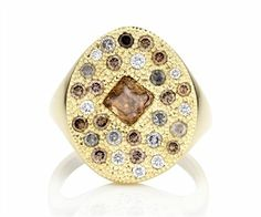 Debeers signet ring with warm colored diamonds and gold.