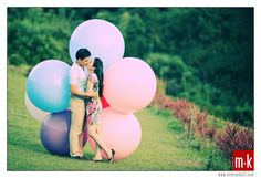 Engagement session with ballons. 99