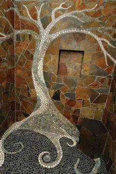 A custom pebble tree and shower pan with slate wall tiles and a basalt bench.