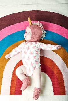 This rainbow rug is the perfect pop of color and pattern for a playroom!