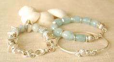 Think Spring vacation! Sterling silver bracelets with aventurine stones. Layer pieces to create a dramatic look.