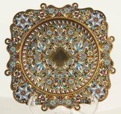 """ANTIQUE RUSSIAN SILVER GILT & CLOISONNE ENAMEL CIGARETTE TRAY, MAKER'S MARK  """"KA,"""" mOSCOW, cIRCA 1899-1908. Floral arabesques in opaque and translucent cloisonne enamel ornament the rim and cavetto. Mounted on four ball feet"""