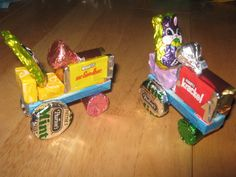 Easter candy tractors I made for my son's class.    1 pkg of gum for main body  2 hershey's minutures   2 Starburst for tractor seat  2 peppermints for back wheels   2 rolo's for front wheels  1 hershey's kiss for steering wheel  and to easter it up  1 small chocolate bunny  could use santa for christmas time or even leave empty.    Hot glue together.