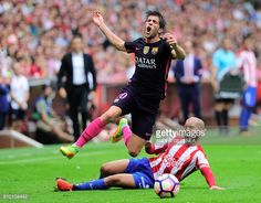 Barcelona's midfielder Sergi Roberto is tackled by Sporting Gijon's defender Alberto Lora during the Spanish league football match Real Sporting de...