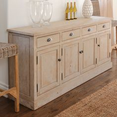 Features:  -1 Center shelf and 2 side shelves.  -Removable shelves.  -Double roller cabinet catch.  Product Type: -Sideboard.  Hardware Finish: -Gunmetal Finish.  Distressed: -Yes.  Base Material: -Wo