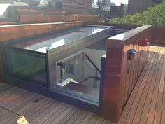 For the ultimate in terrace access we manufacture sliding box skylights with openings. We've installed free-standing box rooflights, our standard three-wall versions and even custom-built box rooflights f. Roof Terrace Design, Roof Design, House Design, Door Gate Design, Retractable Pergola, Roof Window, H & M Home, Roof Light, Rooftop Terrace