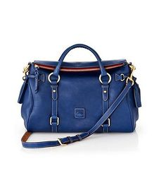 A roomy, zip-top satchel isn't falling out of favor any time soon - grab one in a deep blue color