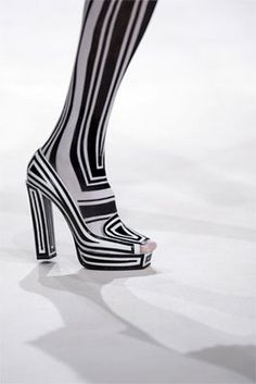 Viktor & Rolf-WOW!  SHINY doesn't seem adequate in a description of this boot!