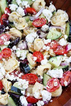 GREEK TORTELLINI SALAD; 20oz tortellini, 1-1/2c grape tomatoes, 1lrg cucumber, 1c kalamata olives, 1/2 red onion, 3/4c feta cheese; DRESSING: 1/4c extra virgin olive oil, 3Tbsp red wine vinegar, 1 clove garlic, 1/2tsp dried oregano, salt & pepper to taste