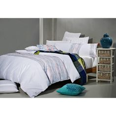 Snuggle up with this 7-piece queen size bed set featuring Egyptian cotton. This mostly white duvet cover set will make your bed look like a fluffy cloud for a heavenly sleep, and the thin colored stripes add a bit of style to your room.