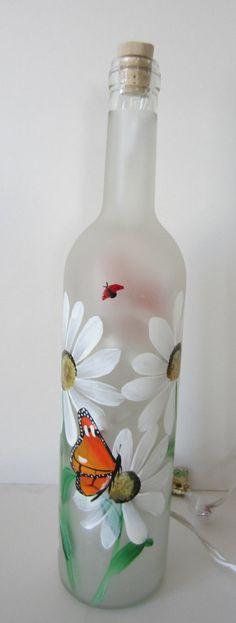 Butterfly Daisy Lady Bug Frosted Lighted by EverythingPainted Wine Bottle Design, Wine Bottle Art, Glass Bottle Crafts, Wine Bottle Lanterns, Lighted Wine Bottles, Painted Glass Bottles, Painted Wine Glasses, Bottle Painting, Jar Crafts