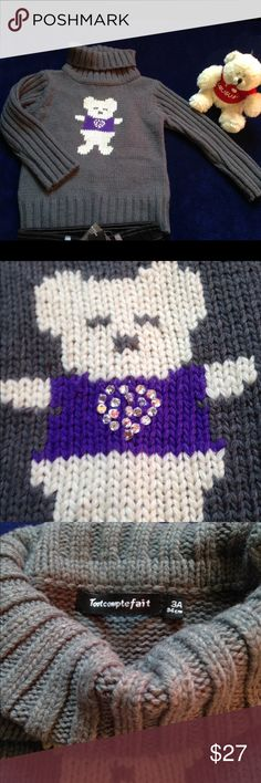 Grey turtle neck toddler girl sweater sz 3 Grey girls turtle neck sweater with cute white and purple bear designed on the front with a beaded heart. Size 3 40% polyammide, 20% cotton, 20% acrylic, 20%wool  Tout Compte Fait Shirts & Tops Sweaters