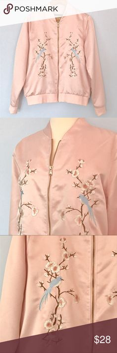 """Blush Pink Satin Embroidered Bomber Jacket Coat Blush pink satin embroidered bomber jacket.  Rose gold zipper.  Pockets.  Fully lined.  Blue birds and floral branches embroidered on the front.  Banded cuffs and waist.  100% polyester.  In excellent condition.  Approx. flat lay measurements: length 24"""", width across underarms 22 1/2"""", sleeve 25"""", shoulder width 16"""". Ci Sono Jackets & Coats"""