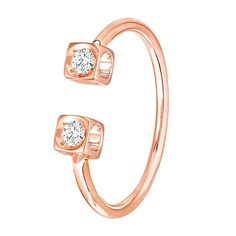 Dihn Van Le Cube Diamant rose gold ring with two white diamonds in an open style. Discover the French jeweller whose minimalist fashion forward use of gold and diamonds is setting a new modern style for jewellery. http://www.thejewelleryeditor.com/jewellery/article/dinh-van-minimalist-diamond-jewellery-starkly-beautiful/ #jewelry