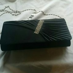 Black Clutch with Rhinestones New clutch with hidable 44 inch chain. Clutch has small pocket inside. Measures 9.5x4.5x2. 100% Polyester. Bags Clutches & Wristlets
