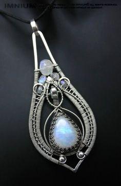 Moonstone teardrop pendant by IMNIUM.deviantart.com on @deviantART