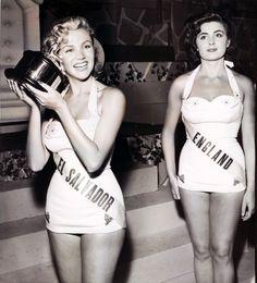 Miss El Salvador (Mariel Arrieta) wins the Miss Friendship trophy, 1955. Miss England does not look pleased...