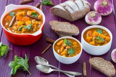 Autumn Vegetable Stew Recipe Soups, Main Dishes with onions, carrots, celery ribs, garlic, ginger, sweet paprika, ground cumin, ground coriander, cinnamon sticks, vegetable stock, butternut squash, turnips, russet potatoes, crushed tomatoes, chickpeas, warm water, saffron, mint, ground black pepper, salt, chopped cilantro