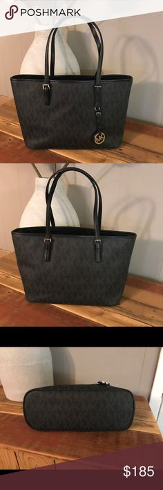 "Michael Kors Black and Grey Leather Tote EUC like new gently used Michael Kors Tote. I used this to carry my 13"" laptop. Interior has a middle zip compartment with a side slip pocket the length of the bag, 1 zip pocket, and two slip pockets on both sides. Approx: 14.5""L x 9.25""H x 5""W, strap drop 8.5"" KORS Michael Kors Bags Laptop Bags"