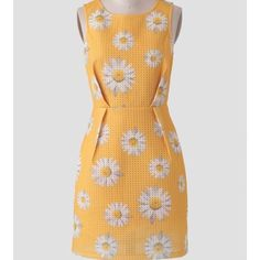 Yellow daisy sheath dress Very flattering. Marked large but runs a tad small. Ina  Dresses
