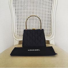 Vintage Chanel Handbag in Black Silk with Gold Hardware Very Good to Unused Condition (size 14x10x3.5 cms) 38500 baht