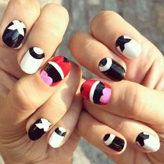 Fashion week beauty musts: Offset a serious outfit with graphic nail art made for social media moments.