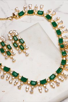 With luxury at its core, this CZ necklace set is one of the most sought after jewels at Tarinika. Inspired from solitares, this necklace is crafted thoughtfully with utmost precision to meet your special needs.   In the mood of western look or traditional look? this is perfect necklace to match with your gown or saree. Real Gold Jewelry, Fancy Jewellery, Gold Jewellery Design, Emerald Jewelry, Diamond Jewellery, Pearl Jewelry, Wedding Jewelry, Beaded Jewelry, Jewlery