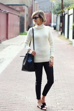 black bucket Mansur Gavriel bag - ivory turtleneck banana republic sweater