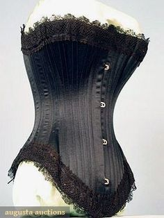 Black Corset 1880s. Like the low front and high hip. Black can be a challenge and sometimes boring, the satin makes it special again.: