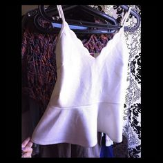 Sz.M White peplum tank BNWT Brand new with tags Sz.M White peplum tank BNWT. Almost like a crop tank peplum hits at midriff. Tops Tank Tops