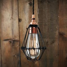 With an eye-catching design, the Juba Cage Pendant Light can easily blend into any modern environment. This industrial ceiling fixture would look great over a large dining or kitchen table, but could also be used to light up a hallway. Designed to showcase the warmth of Edison-style bulbs, this industrial pendant light features an adjustable wire cage that can be altered easily to your own preference. Suitable for an industrial and minimalist interiors, this wire cage pendant light adds…
