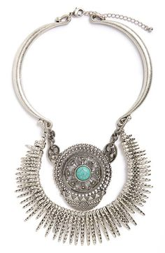 Free shipping and returns on Sole Society Turquoise Stone Statement Necklace at Nordstrom.com. A turquoise stone forms the dazzling centerpiece of a stunning statement necklace that features intricate filigree, geometric elements and textured dagger beads.