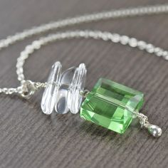 St Patricks day necklace featuring a green Swarovski crystal pendant with rock crystals and sterling silver tear drop.