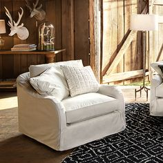 Leeward Slipcovered Swivel Chair is a classic look.