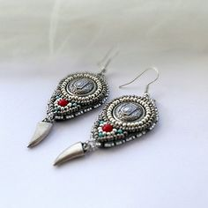 Hey, I found this really awesome Etsy listing at http://www.etsy.com/listing/77636052/silver-grey-earrings-etnic-style-bead