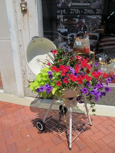 Barbeque grill planter.  What a great way to repurpose your old grill.