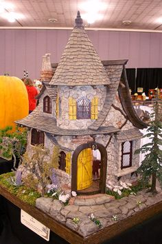 """Good Sam Showcase of Miniatures:  by Jay Kent entitled """"Jay's Folly"""" is a diminutive and fanciful storybook structure."""