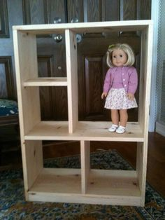 And in open side put clothes rod toward back then pegs on each side to hold dolls.