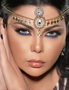 Haifa Wehbe - creative eye makeup with golden bronze, purple, and blue.