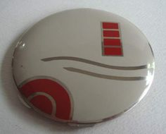 ENGLISH ART DECO COMPACT IN CHROME WITH  ENAMELLED GEOMETRIC DESIGN.
