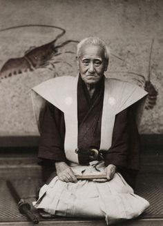 thekimonogallery: Photo of an old samurai, circa 1890, Japan, by photographer Kozaburo Tamamura. The abolishing of the samurai class by the Emperor had occurred in the late 1860's, so by the time this photograph was taken in about 1890, the former samurai still alive were getting elderly, as reflected in this portrait.