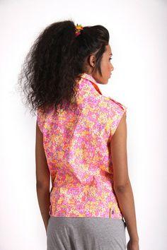 PINK UNDERLAY FLORAL SLEEVELESS DENIM JACKET R 435.00 - All over floral print denim material - Asymmetric zip fastening - Sleeveless cut