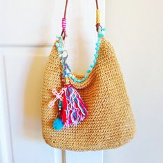 Upcycled hobo style slouchy  bag with handmade charm tassel keychain by MideltonStudioDesign