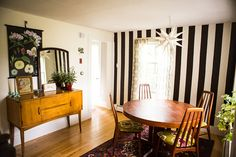 """Dining Room  with  \Evolution Store poster and Benjamin Moore """"Black Bean Soup"""" stripes.  Photo by Chattman Photography for Carla Caruso Design*Sponge Sneak Peek."""