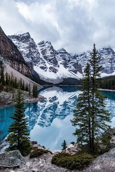 """Moraine Lake is a glacially fed lake in Banff National Park. It is surrounded by mountains, waterfalls, and rock piles, creating a scene so stunning it almost seems unreal. That view of the mountains behind the lake in Valley of the Ten Peaks is known as the """"Twenty Dollar View"""", as Moraine Lake was featured on the reverse side of the 1969 and 1979 issues of the Canadian twenty dollar bill."""