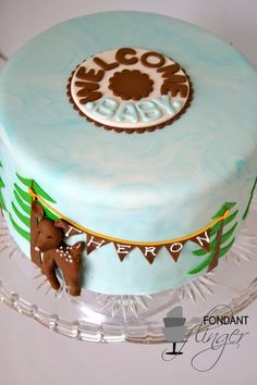 Deer and bunting baby shower cake