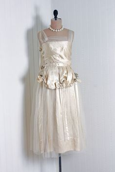 Couture Wedding Dress: ca. 1920's, heavily sculpted silk satin and sheer net/tulle.
