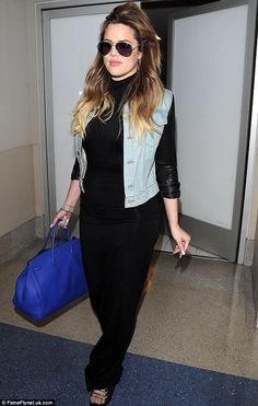 Layered look: Khloe Kardashian kept her curves in check with a spandex black outfit as she jetted out of LAX http://dailym.ai/1uDODQf