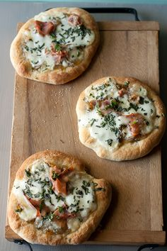 mini pizzas with prosciutto, fontina & caramelized onions.
