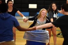 """Ninth-grader Maddison Randall, 14, participates in a relationship-building game during freshmen orientation activities Aug. 3 at Vista Ridge High School in District 49. """"I think I like it here — it's new,"""" said Randall, after the game. """"It's fun. We get to interact with different people."""" Dozens of students in 10th-12th grade were participating as leaders in the school's Alpha orientation and transition program."""